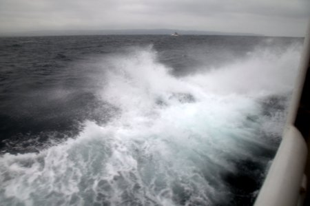 Ferry to Inisheer.  Rough seas with Cliffs of Moher in the background