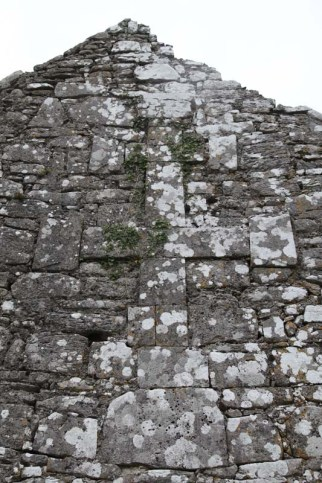 West wall of Church. showing a large cross-of-Lorraine detailed in raised stonework