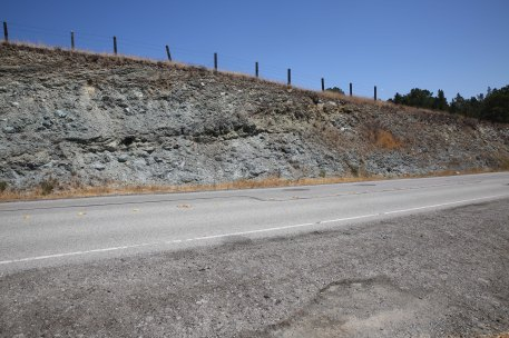 Road cutting with strongly sheared rocks. Near San Andreas Lake