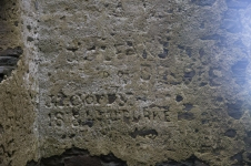 Names carved into the mortar