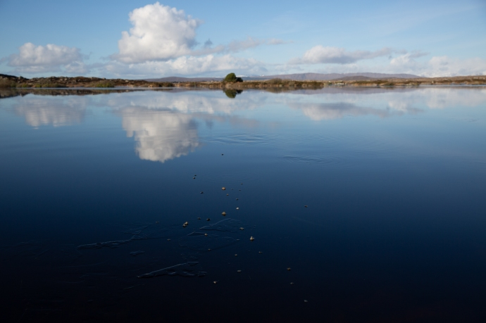Reflections on the ice. Loch Awalia,.  Handful of stones.
