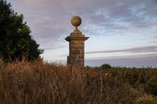 An elaborate gate post survives.